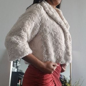Jennifer Lopez fluffy crop jacket